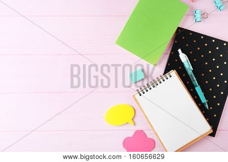School stationery on wooden background, top view