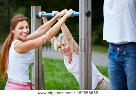 Two women doing fitness training together in nature