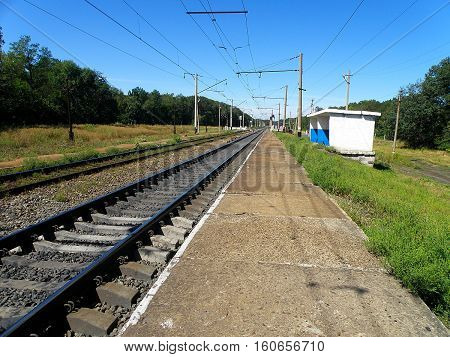 Double-track railway runs past the stopping point of the apron.