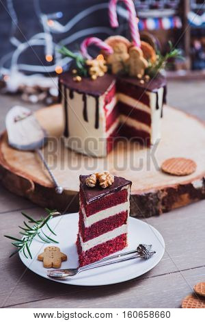 Piece of a homemade red velvet cake decorated for Christmas party