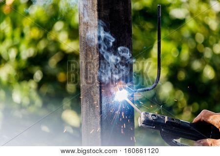 Welder in factory welding metal at Construction site