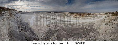 Panorama of chalk quarry mining. Roads for trucks