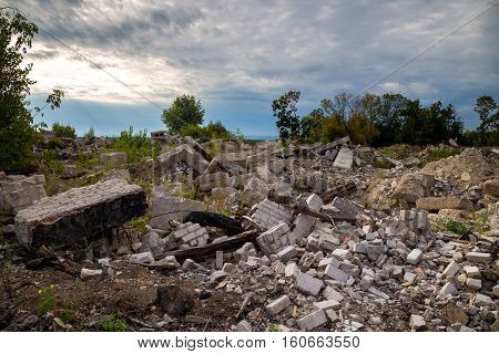 Garbage dump with ruined brick and metal planks. Concept of disaster, war