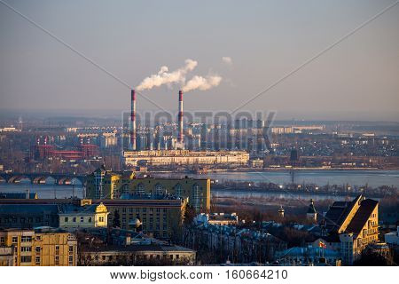 Cityscape view from the roof to Voronezh power station with pipes of which poured smoke on a river