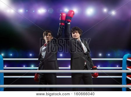Two businessman with boxing gloves in the ring