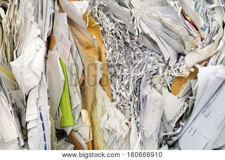 background of shredded paper piled and ready to recycle and go green