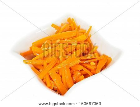 Closeup Of Carrot Cut Into Julienne Slizes In A Beautiful White Bowl Against White