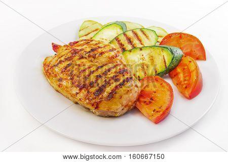 dish is chicken steak with vegetables on white background
