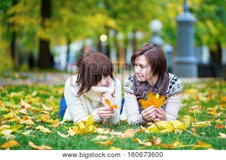Mother And Daughter Having Fun Together On A Fall Day