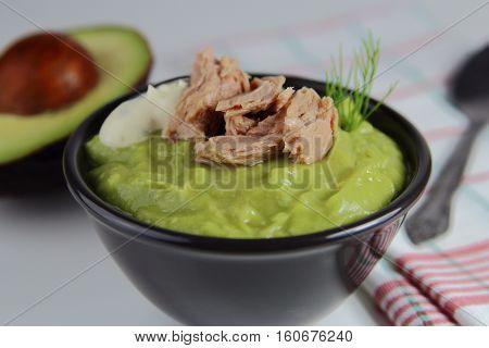 cream avocado soup with tuna and greens