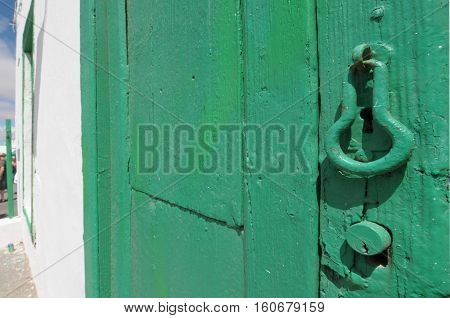 Aged Green Wooden Door With Lock
