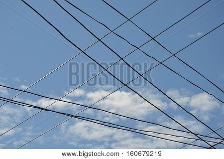 electric cable wire intersection on sky background
