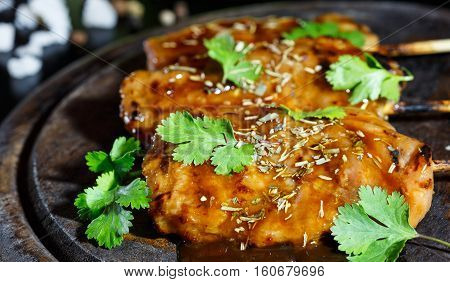 Food steak ready for serving on wood plate and black background fresh steak from pork and beef seasoning by vegetable and spices.