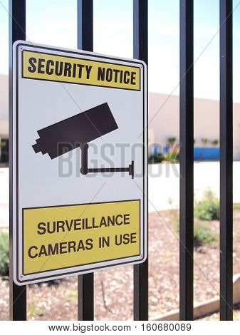 Camera surveillance sign on a steel fence of an industrial estate Melbourne Australia 2016