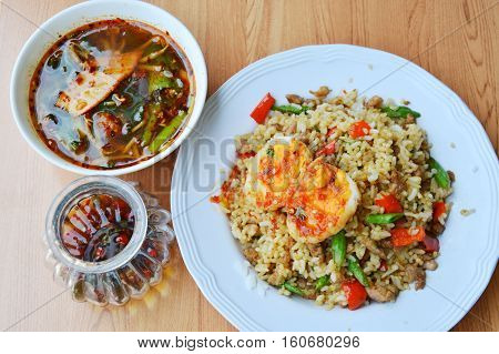 spicy fried rice with minced pork topping sweet egg and soup