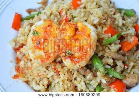 spicy fried rice with minced pork and basil leaf topping sweet egg
