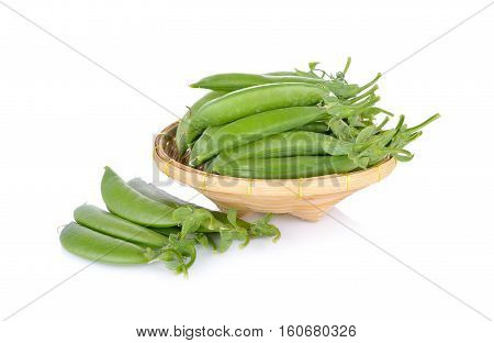 fresh sugar snap pea or green pea in bamboo basket on white background