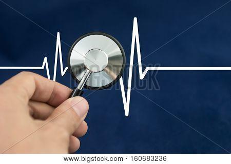 Stethoscope on the ECG. medical symbol .
