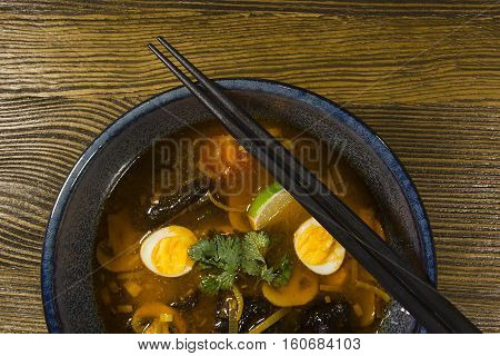 Asian ramen soup on a wooden table