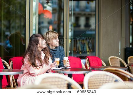 Dating Couple Drinking Coffee In Cafe