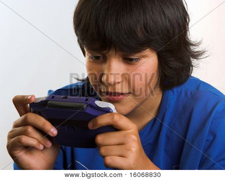 Boy playing on his game-boy