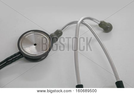 Closeup medical stethoscope old used long-standing on the table