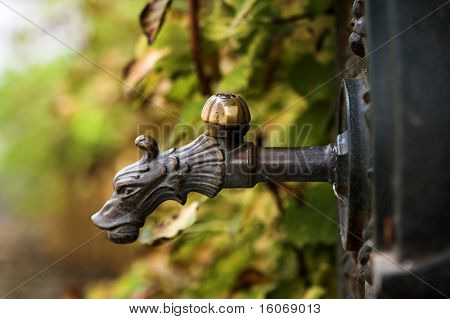 Antique water tap in a village road