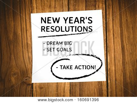 New year resolution goals written on sticky notes against wooden background