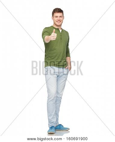 gesture and people concept - young smiling man showing thumbs up over white