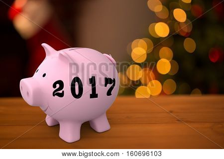 Digital image of new year 2017 against desk with christmas tree in background