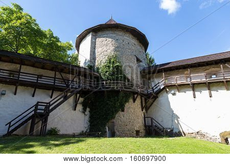 Old medieval castle in Banska Stiavnica Slovakia. Interior courtyard with fortified wall and round stone tower. UNESCO Cultural Heritage.