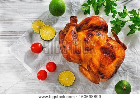 Barbecued Whole Chicken With Crispy Golden Crust Skin. Top View