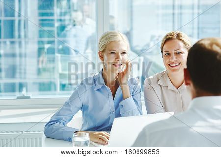 Businesswomen listening to male point in office