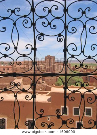 Grille Gate With A Red Fortress Behind, Taourirt Kasbah, Ouarzazate, Morocco
