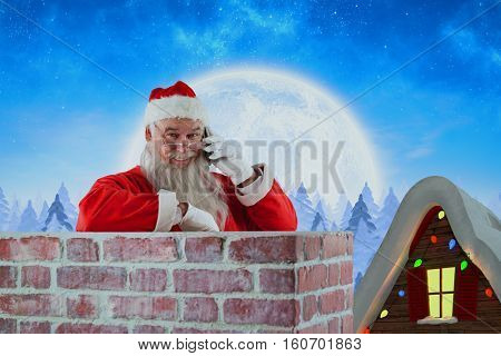 Santa Claus standing beside chimney and talking on mobile phone against winter snow scene