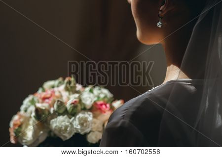 The bride with a bouquet. Close-up of catkins