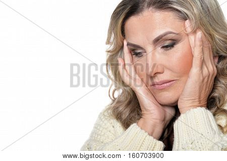 Portrait of tired mature woman isolated on white background