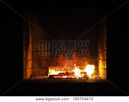 The fire in the fireplace. Firewood charcoal beautiful spark