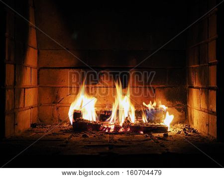 The fire in the fireplace. Firewood charcoal flames