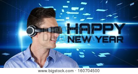 Happy handsome man with virtual reality simulator against blue technology design with glow