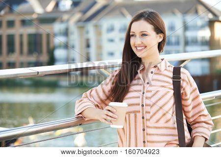 Young Woman Walking To Work In Urban Setting