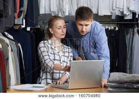 Couple Running On Line Fashion Business Using Laptop