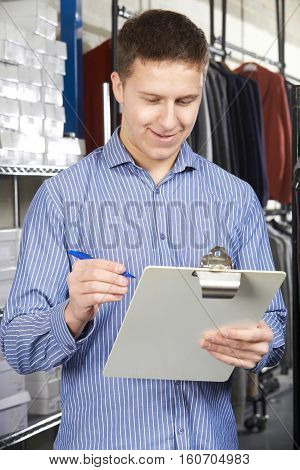 Businessman Running On Line Fashion Business With Clipboard