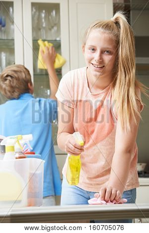 Portrait Of Children Helping to Clean House