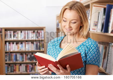 Young Female Student Studying In University Library