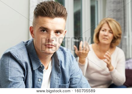 Bored Teenage Boy Being Told Off By Mother