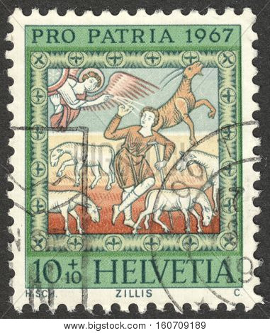 MOSCOW RUSSIA - CIRCA NOVEMBER 2016: a post stamp printed in SWITZERLAND shows Proclamation to the shepherds the series