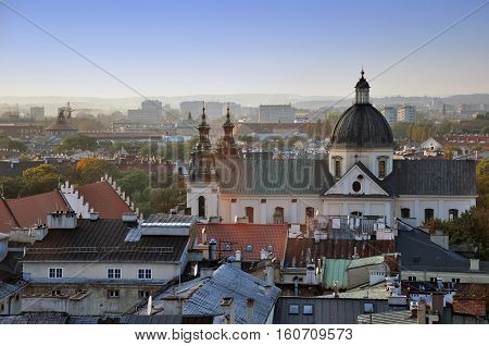 Krakowб Poland - October 10б 2014: Aerial view of the Krakow. The roofs of old buildings and the church tower.