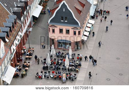 SPEYER, GERMANY - APRIL 11, 2015. Panorama of Speyer, Rheinland-Pfalz, Germany. Top view of the street cafe and old houses.