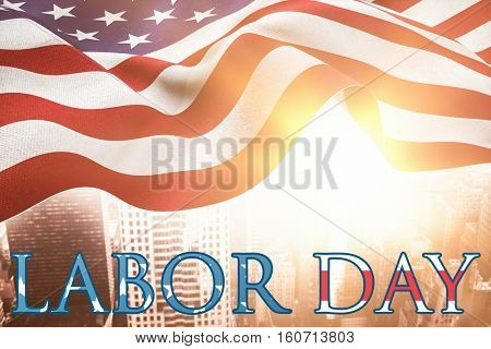 Poster of labor day text against aerial view of a city on a cloudy day